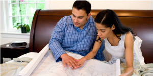 Couple looking at house floor plan.