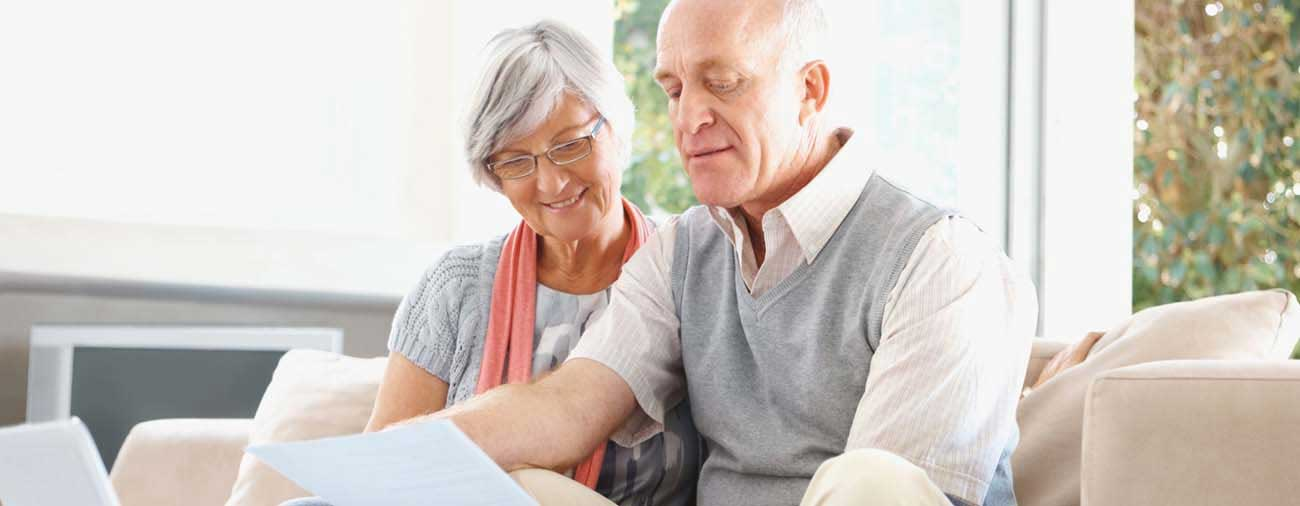 Older couple reviewing statements