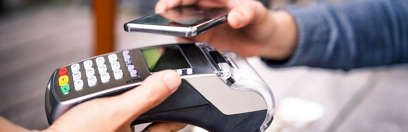 Phone being held over a and card reader